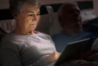 493ss_thinkstock_rf_photo_of_senior_woman_using_laptop_in_bed
